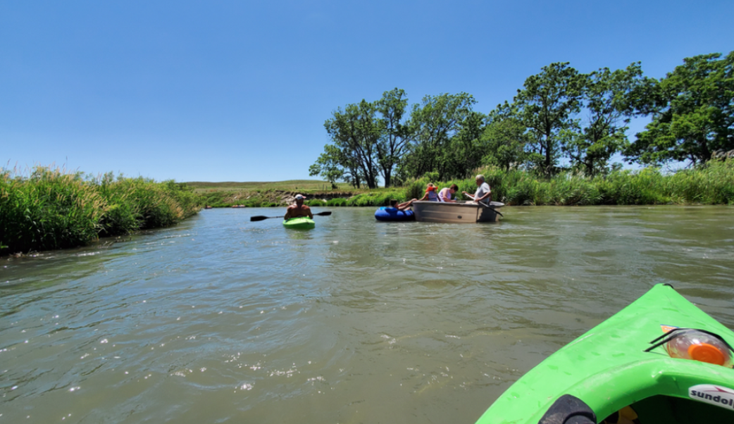 Kayakers and tankers on a float with Sandhill River Trips