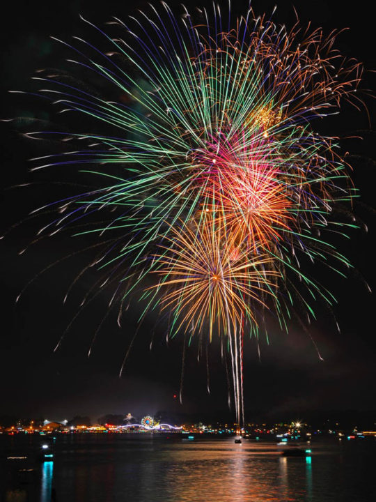 Fireworks over Lake Okoboji with Arnold's Park Amusement Park in the background