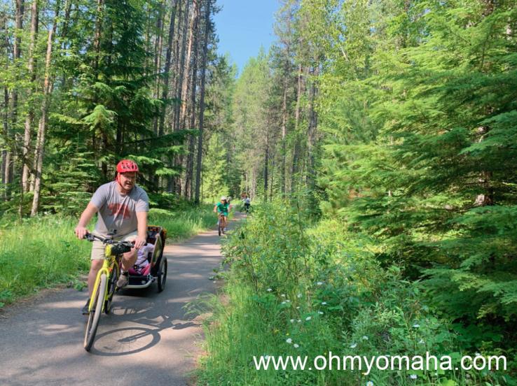 Riding bikes along the Apgar Bike Trail in Glacier National Park