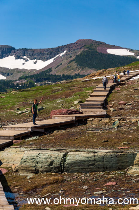 Boy on the stairs at Hidden Lake Overlook Trail at Logan Pass