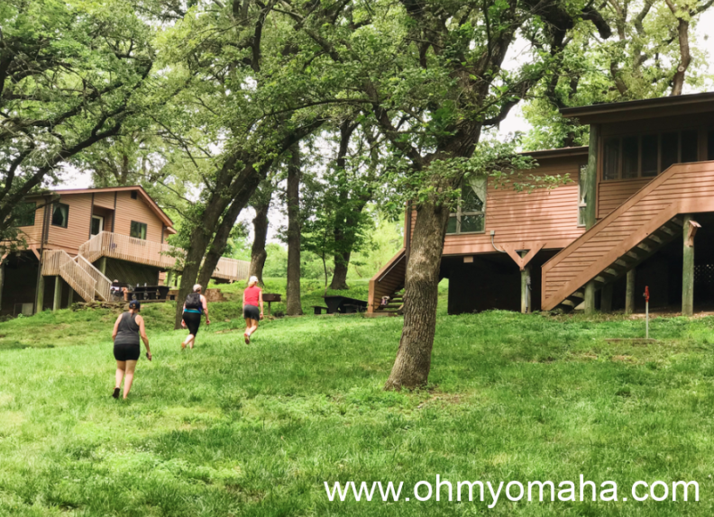 A grub of women walk toward a cabin cabins at Platte River State Park.