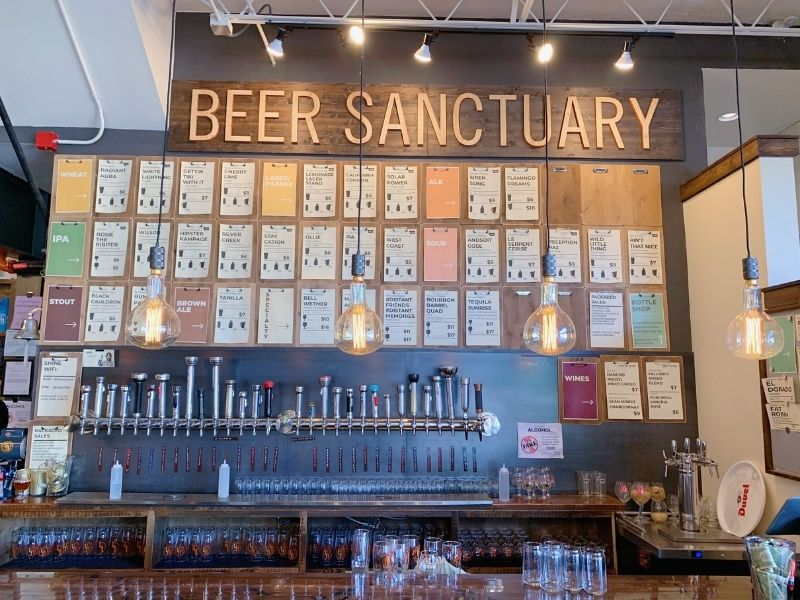 A wall of beers at Beer Sanctuary inside La Para + Shine in Bozeman.