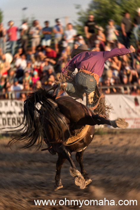 A cowboy is bucked off a bronco at the Brash Rodeo in Columbia Falls.