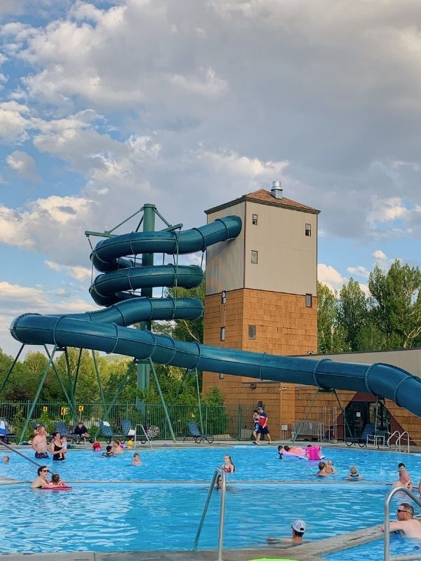 The slide and outdoor pools at Fairmont Hot Springs Resort