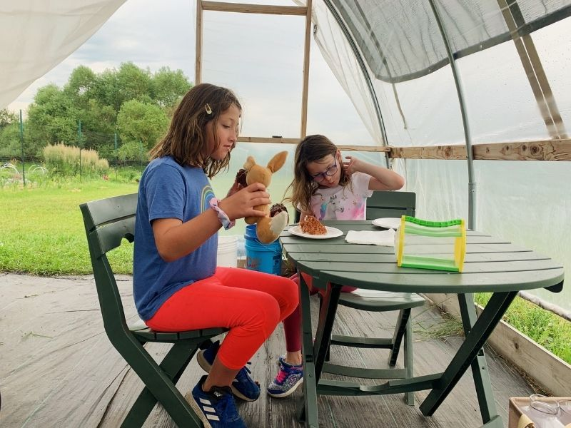 Eating breakfast inside the greenhouse at Hurst Flower Meadows