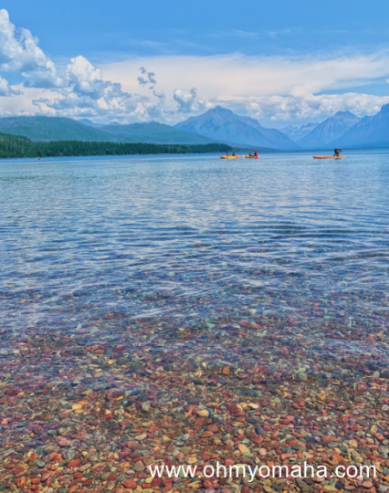 Kayakers in the distance at Lake McDonald in Glacier National Park.