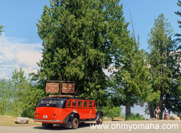 A Red Bus parked in Apgar Village by Lake McDonald.