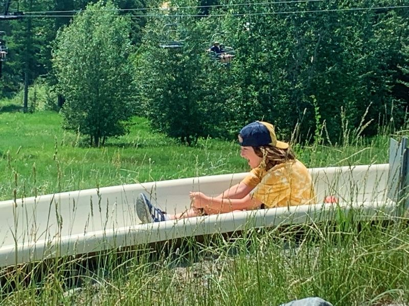 Girl riding down the alpine slide at Whitefish Mountain Resort