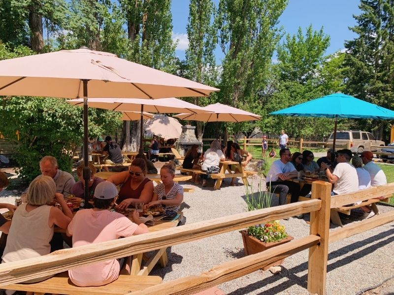 The outdoor seating area at Wich Haus inn Whitefish
