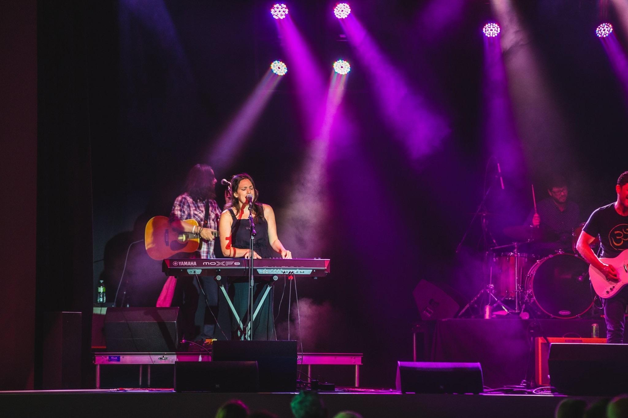 "Tara Vaughan sings and plays keyboard during ""She Rocks"""