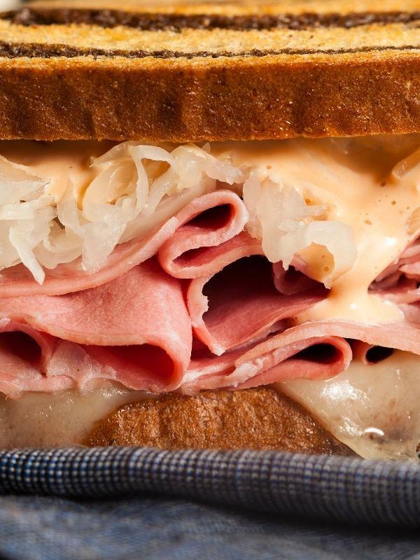 A close-up photo of a Reuben sandwich