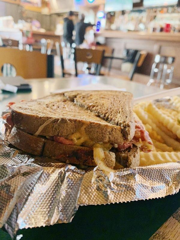 A Reuben sandwich and fries at Barrett's Barleycorn Pub & Grill